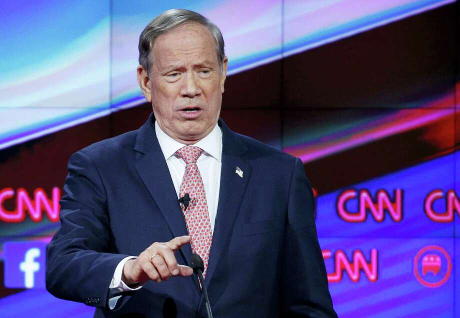 FILE - In this Dec. 15, 2015, file photo, George Pataki makes a point during the CNN Republican presidential debate at the Venetian Hotel & Casino in Las Vegas. Pataki is telling supporters on Tuesday, Dec. 29, he's ready to drop his bid for the Republican presidential nomination. Photo: AP Photo/John Locher, File / AP