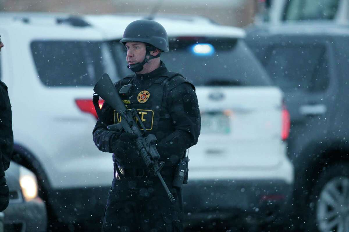 Police stand guard at the intersection of Centennial and Fillmore near a Planned Parenthood clinic Friday, Nov. 27, 2015, in Colorado Springs, Colo. A gunman opened fire at the clinic on Friday, authorities said, wounding multiple people.