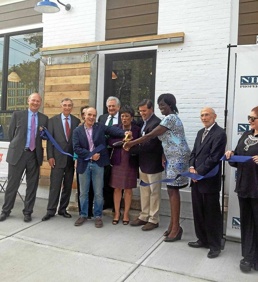 MARY O'LEARY — NEW HAVEN REGISTER   From left, Matthew Nemerson, Bruce Alexander, Andre Corazzini, Henrique Salas-Romer, Mayor Toni Harp, Juan Salas-Romer, Alder Jeannette Morrison and David Silverstone at Ashmun Flats. Photo: Journal Register Co.