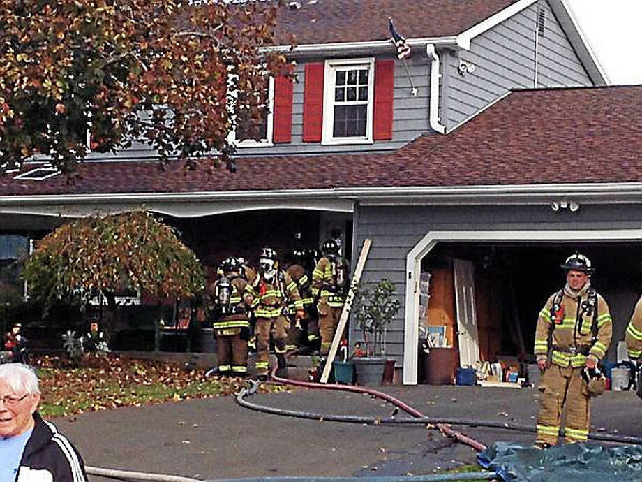 Firefighters at the scene of a fire on Marion Court in North Haven Thursday. Photo: Brian Zahn — New Haven Register