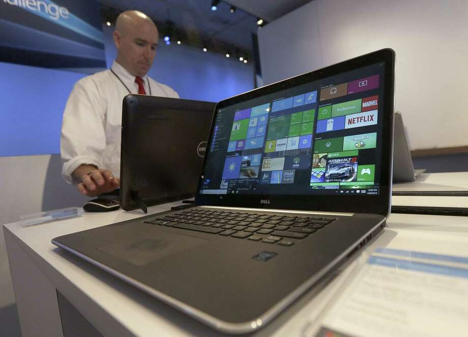 In this April 29, 2015 photo, a Dell laptop computer running Windows 10 is on display at the Microsoft Build conference in San Francisco. Photo: AP Photo/Jeff Chiu, File   / AP