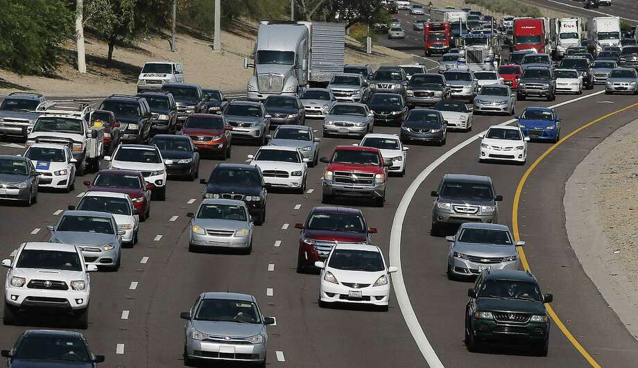 FILE - In this June 24, 2015, file photo, afternoon rush our traffic moves along a highway in Phoenix. The average vehicle in the U.S. is now a record 11.5 years old, according to consulting firm IHS Automotive, a sign of the increased reliability of today's vehicles and the lingering impact of the sharp drop in new car sales during the recession. Photo: THE ASSOCIATED PRESS / AP