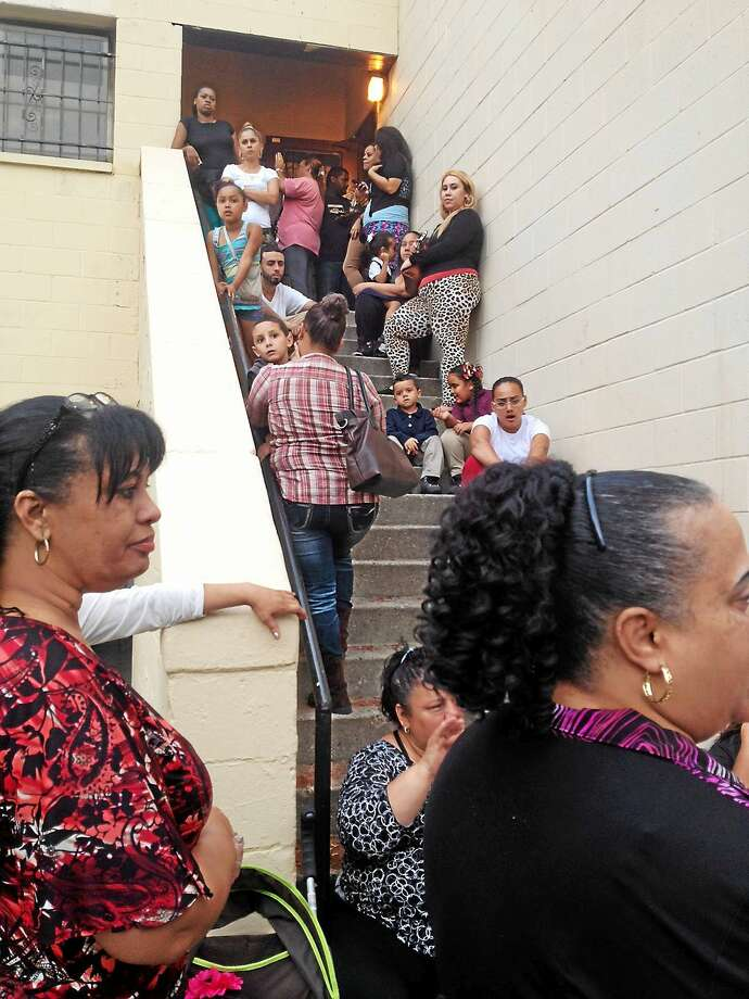 A crowd shut out of meeting at Church Street South had to wait for a second session to begin when the housing complex community room quickly filled up. Photo: MARY O'LEARY — NEW HAVEN REGISTER