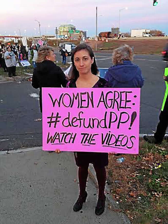 Nicole Stacy, a public policy assistant with the Family Institute of Connecticut, protests with fellow anti-abortion activists outside Long Wharf Theatre Thursday in New Haven, where Planned Parenthood President Cecile Richards spoke as a guest of Planned Parenthood of Southern New England. Photo: Brian Zahn — New Haven Register