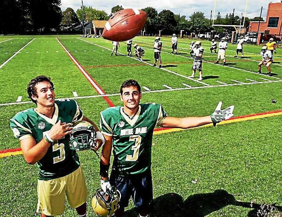 Notre Dame-West Haven quarterback Christian Lupoli, left, and receiver Nico Ragaini are expected to lead the way for the Green Knights this season. Photo: Peter Hvizdak -- The New Haven Register