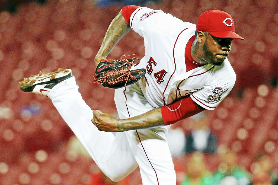 Reds relief pitcher Aroldis Chapman was traded to the Yankees on Monday. Photo: John Minchillo — The Associated Press   / AP