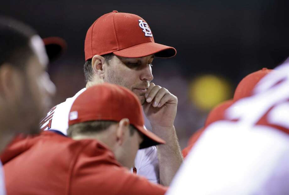 St. Louis Cardinals' Adam Wainwright is seen on the bench during the eighth inning of a baseball game against the Cincinnati Reds on Tuesday, Sept. 22, 2015, in St. Louis. (AP Photo/Jeff Roberson) Photo: AP / AP