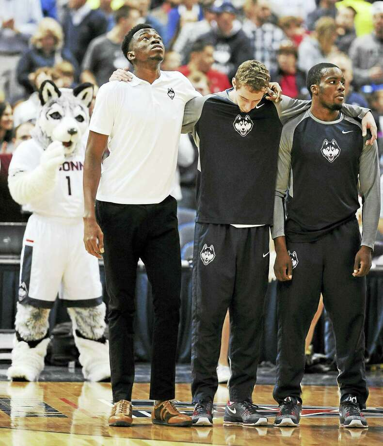 UConn will be without center Amida Brimah, left, on Tuesday against Texas. The junior is expected to miss 6-8 weeks. Photo: The Associated Press File Photo   / FR125654 AP