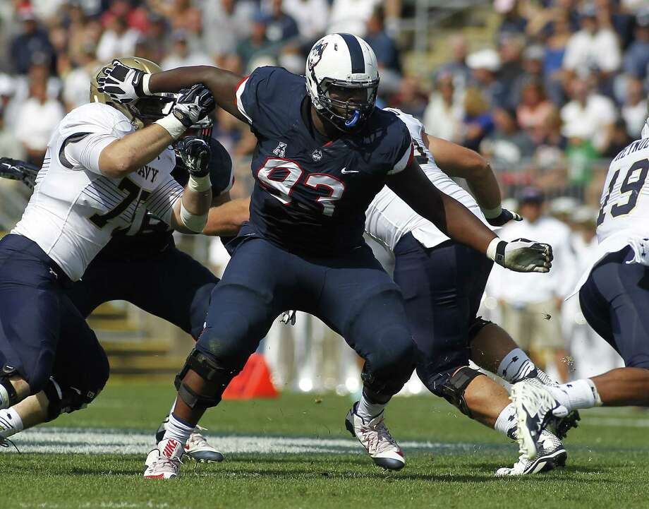 Connecticut defensive lineman Foley Fatukasi (93) during the second quarter of an NCAA college football game against Navy, Saturday, Sept. 26, 2015, in East Hartford, Conn. Three years after Superstorm Sandy forced his family from their home, Connecticut's Fatukasi has settled into a central part of the Huskies defensive line. Photo: AP Photo/Stew Milne   / FR56276 AP