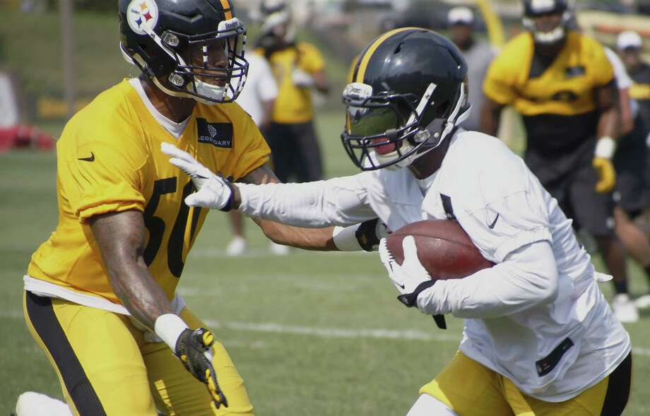 Pittsburgh Steelers running back Le'Veon Bell, right, runs the ball as inside linebacker Ryan Shazier (50) defends during practice on Monday in Latrobe, Pa. Photo: Keith Srakocic — The Associated Press   / AP