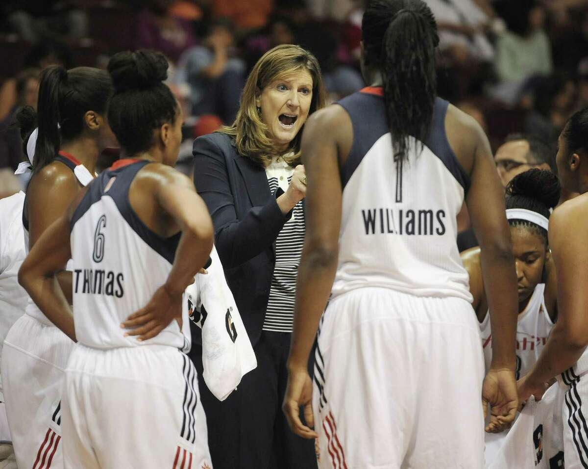 Connecticut Sun head coach Anne Donovan, center, talks to her team during the second half of a game against the Indiana Fever Tuesday. Indiana won in overtime, 75-73.