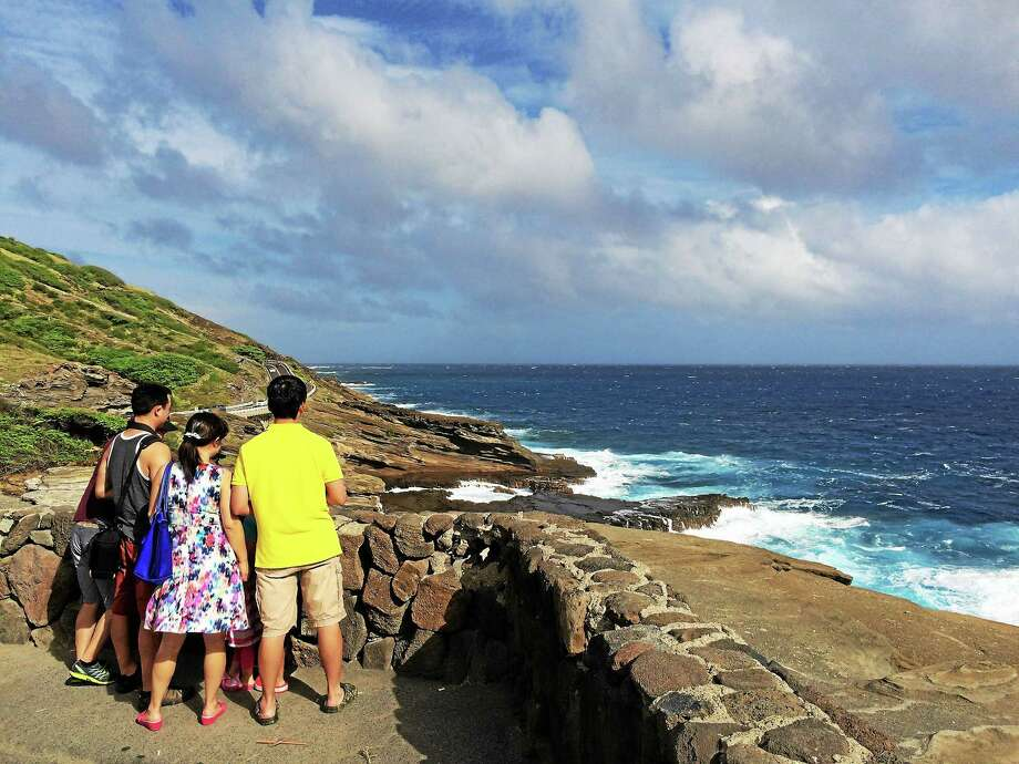 Visitors take in the ocean from Lanai Lookout in Honolulu. It is near where President Obama scattered his mother's and grandmother's ashes, and the state capital's mayor and other have suggested renaming it for the president. Washington Post photo by Greg Jaffe Photo: The Washington Post / The Washington Post
