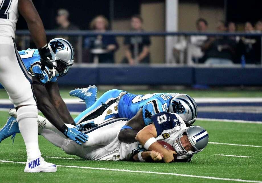 Dallas Cowboys quarterback Tony Romo is sacked by Carolina Panthers linebacker Thomas Davis (58) in the second half Thursday. Photo: Michael Ainsworth — The Associated Press   / FR171389 AP