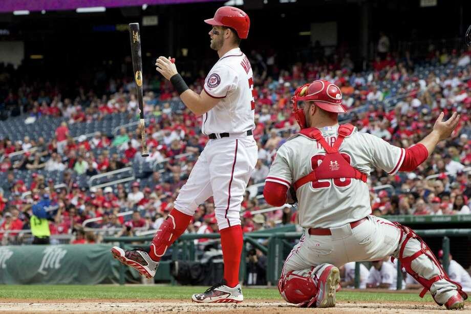 The Nationals' Bryce Harper (34) flips his bat in the air while batting in the first inning Sunday. Photo: Jacquelyn Martin — The Associated Press   / AP