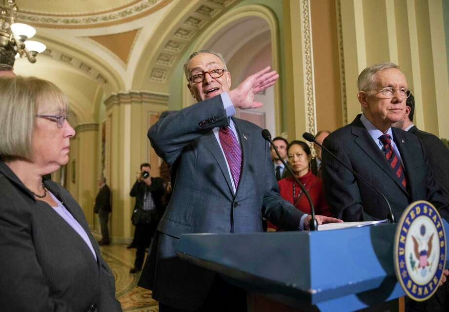 FILE - In this Dec. 8, 2015, file photo, Sen. Chuck Schumer, D-N.Y., joined by Sen. Patty Murray, D-Wash., left, and Senate Minority Leader Harry Reid, D-Nev., right, criticizes Republicans for not doing enough to stop gun violence, during a news conference on Capitol Hill in Washington. Photo: (AP Photo/J. Scott Applewhite, File) / AP