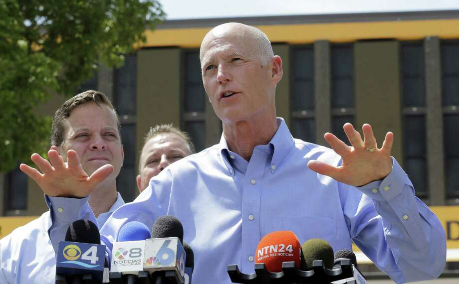 """Gov. Rick Scott, right, talks to reporters at the Miami-Dade State Emergency Operations Center as Lt. Gov. Carlos Lopez-Cantera, left,  looks on Friday, Aug. 28, 2015, in Doral, Fla. Gov. Rick Scott said Friday that Tropical Storm Erika poses a """"severe threat to the entire state"""" and declared  state of emergency. Scott made his declaration shortly after forecasters adjusted the trajectory of the storm to show that it's predicted to strike the southern tip of the state and then traverse northward. Photo: AP Photo/Alan Diaz    / AP"""