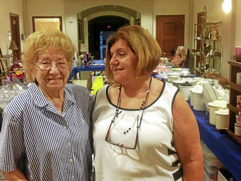 Helen Faraclas, 89, left, started the Treasures and Junk white elephant sale at the first Greek Festival 35 years ago and still works it. Her daughter Anne, right, helps her mom, among other duties. Photo: Contributed Photo