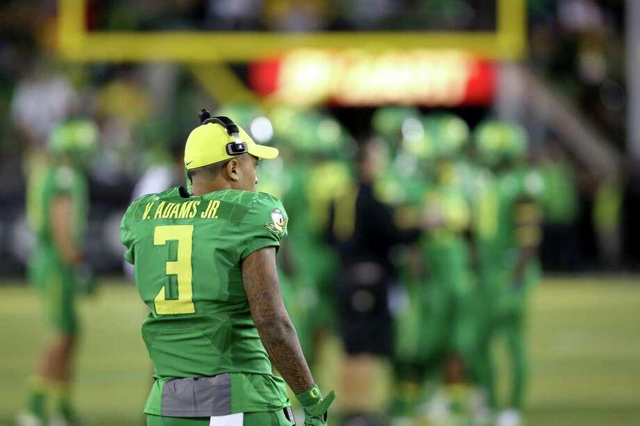 Oregon quarterback Vernon Adams Jr. waits on the sideline during the second half of Saturday's loss to Utah. Photo: Ryan Kang — The Associated Press   / FR171219 AP