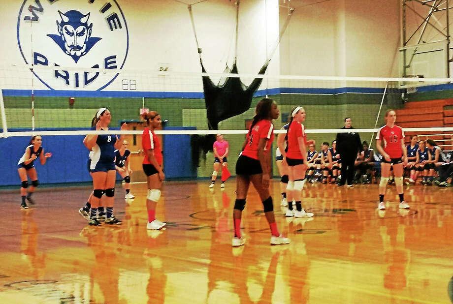 The West Haven girls volleyball team awaits a Platt tech serve during the Westies' sweep. Photo: Mike Madera -- GameTimeCT
