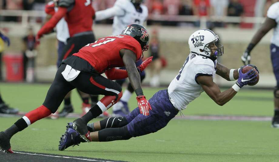 TCU wide receiver Josh Doctson catches a pass against Texas Tech defensive back Thierry Nguema during the second half Saturday. Photo: LM Otero — The Associated Press   / AP