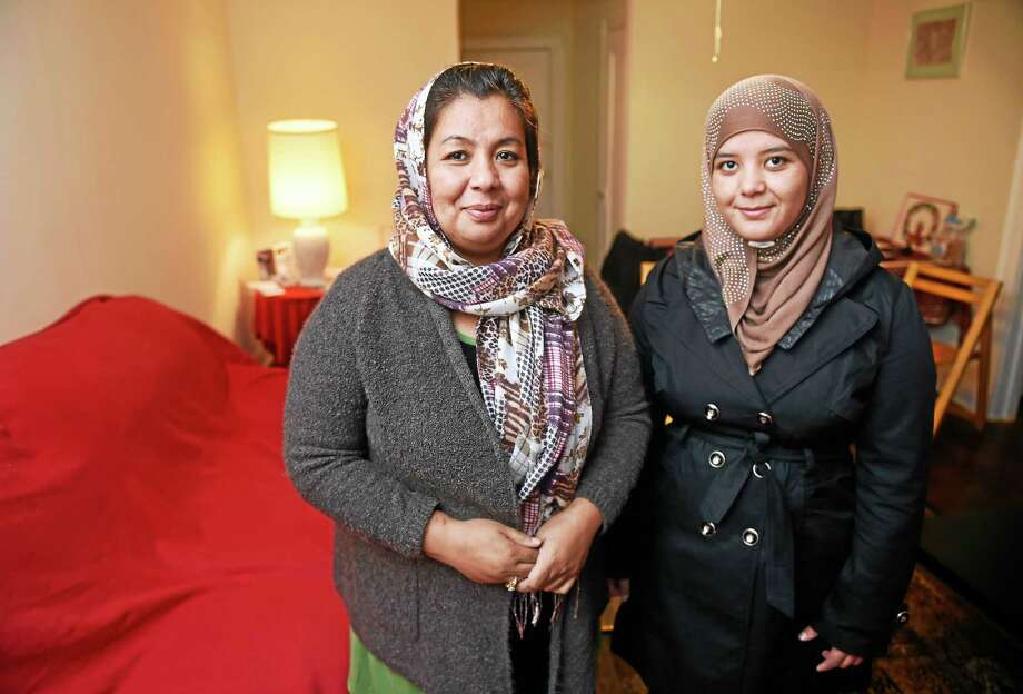 Afghan refugees Fazila Mansoori, left, and her daughter, Hashima, are photographed in their apartment in New Haven. Photo: Arnold Gold — New Haven Register