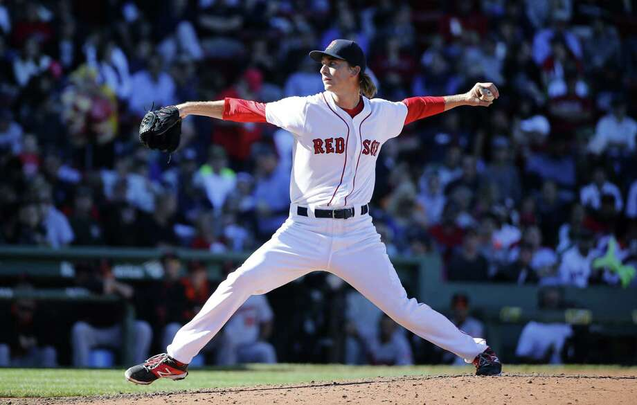 Henry Owens pitches during the sixth inning of Sunday's game against the Orioles. Photo: Michael Dwyer — The Associated Press   / AP