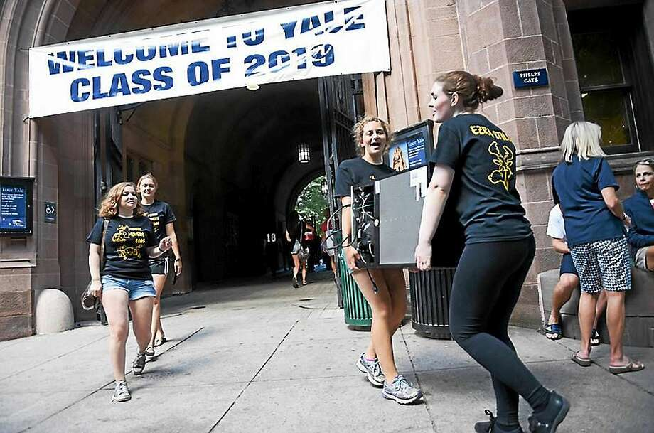 Freshman move their belongings into dorms on Old Campus at Yale University Friday in New Haven. Photo: Arnold Gold — New Haven Register