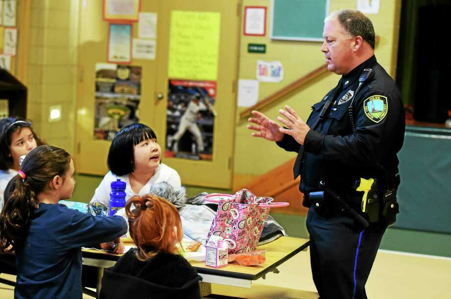 East Haven Police Officer Dave Torello, D.A.R.E. program officer, with Tuttle School fourth-graders during lunch in East Haven Friday. Photo: (Peter Hvizdak - New Haven Register)   / ©2015 Peter Hvizdak