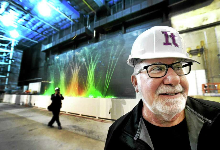 During a tour Wednesday, Eliot Tatelman, Jordan's Furniture president and CEO, stands in front of the choreographed water show component of the It adventure ropes course under construction at 40 Sargent Drive in New Haven. Photo: Peter Hvizdak — New Haven Register   / ?2015 Peter Hvizdak