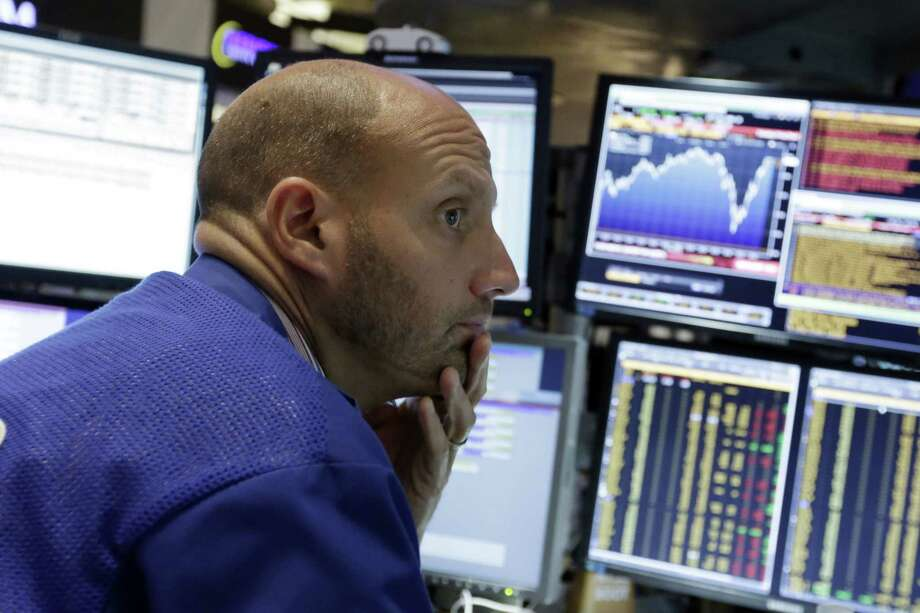 Specialist Meric Greenbaum works at his post on the floor of the New York Stock Exchange Friday. U.S. stocks are opening slightly lower after a sharp two-day surge, as the stock market closes out a wild week. Photo: AP Photo   / AP