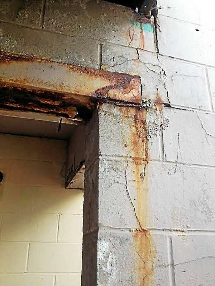 Cracked cinderblock and rusted lintel that provides support for stairs and porch at 6 Great Green section of Church Street South. Photo: Mary O'Leary — New Haven Register