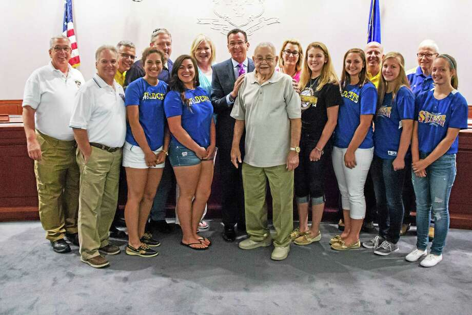 Ambassadors of Seymour softball join state Rep. Theresa Conroy, D-Seymour, Gov. Dannel P. Malloy and state Rep. Themis Klarides, R-Derby, at the state Capitol to celebrate a state grant for a new field. Photo: Contributed Photo