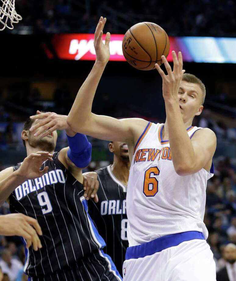 New York Knicks forward Kristaps Porzingis and Orlando Magic center Nikola Vucevic battle for a rebound on Wednesday. Photo: John Raoux — The Associated Press   / AP