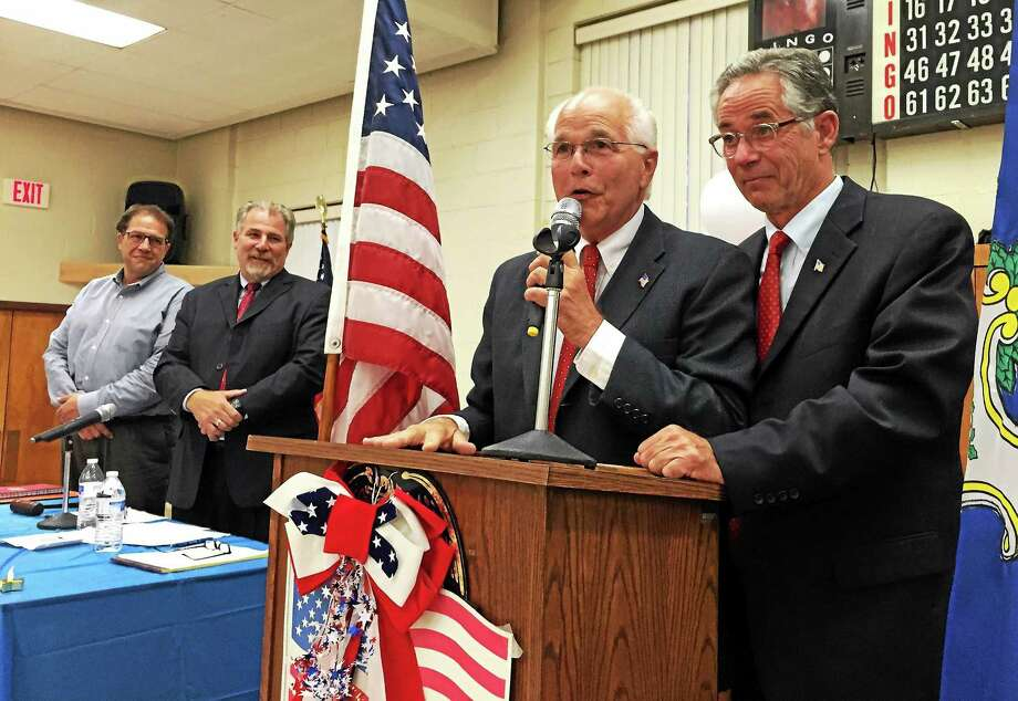 Salvatore Maltese, left, addresses members of the Republican Town Committee after Mayor Joseph Maturo Jr., right, was chosen as the party's mayoral candidate Monday in East Haven. Photo: Esteban L. Hernandez — New Haven Register