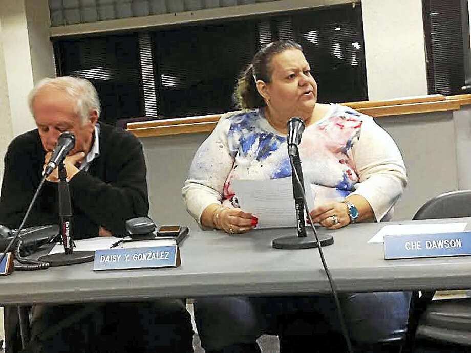 Board of Education member Daisy Gonzalez reads a motion on Dec. 28 to expand legal services between the board and law firm Pullman & Comley. Photo: Brian Zahn — New Haven Register