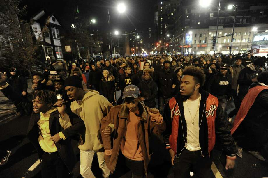 Protesters march during a protest for 17-year-old Laquan McDonald, who was fatally shot and killed in October 2014 in Chicago. Chicago police Officer Jason Van Dyke was charged Nov. 24, 2015 with first-degree murder. Photo: AP Photo/Paul Beaty   / FR36811
