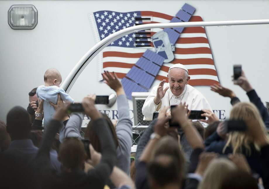 Alessandra Tarantino/AP  Pope Francis arrives for a Mass on the Benjamin Franklin Parkway Sunday in Philadelphia. Photo: AP / AP