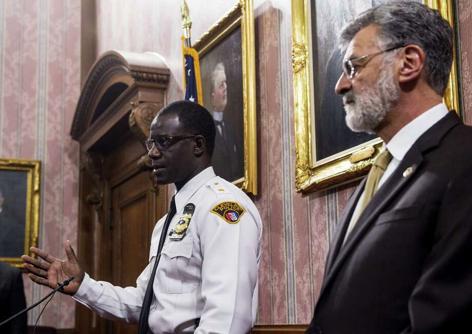 Cleveland police chief Calvin Williams answers questions as mayor Frank Jackson watches during a news conference in Cleveland Monday. Photo: Phil Long — The Associated Press   / FR53611 AP