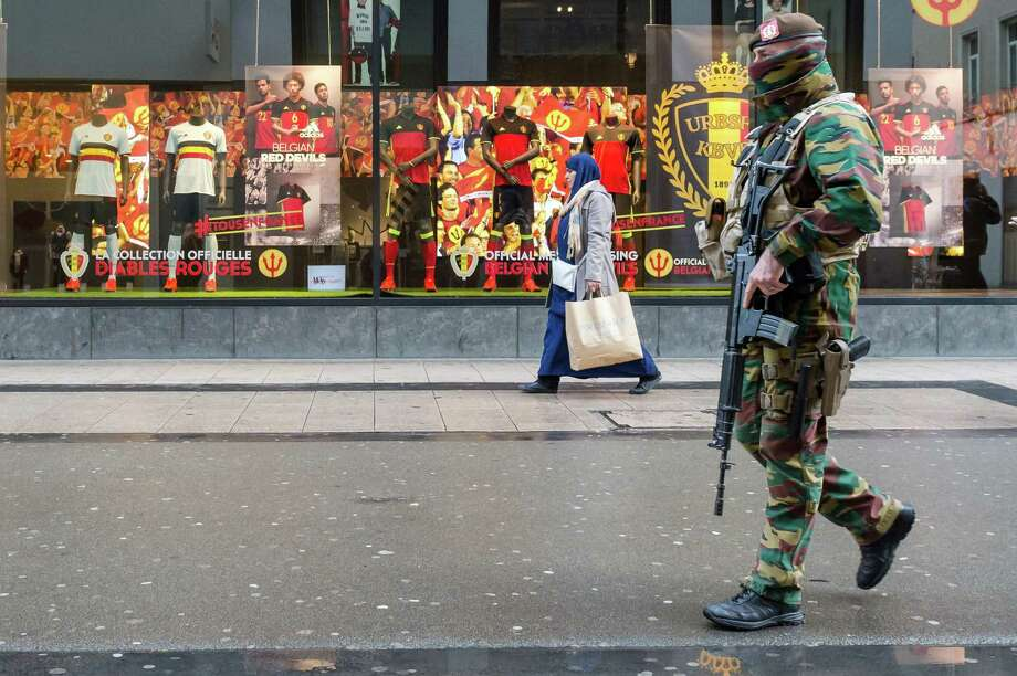 A Belgian Army soldier patrols in a shopping street in the center of Brussels on Nov. 25, 2015. Students in Brussels have begun returning to class after a two-day shutdown over fears that a series of simultaneous attacks could be launched around the Belgian capital. Photo: AP Photo/Geert Vanden Wijngaert   / AP