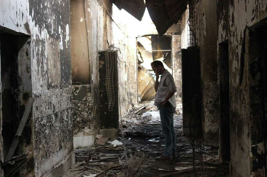 In this Friday, Oct. 16, 2015, file photo, an employee of Doctors Without Borders walks inside the charred remains of their hospital after it was hit by a U.S. airstrike in Kunduz, Afghanistan. An investigative report on the U.S. air attack that killed more than two dozen civilians at a medical charity's hospital in northern Afghanistan last month says the crew of the attacking plane misidentified the target, believing it to be a government compound taken over by the Taliban. Photo: Najim Rahim Via AP    / AP