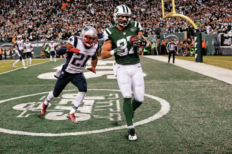 Jets wide receiver Eric Decker (87) catches a pass for a touchdown in front of the Patriots' Malcolm Butler during overtime on Sunday. Photo: Kathy Willens — The Associated Press   / AP