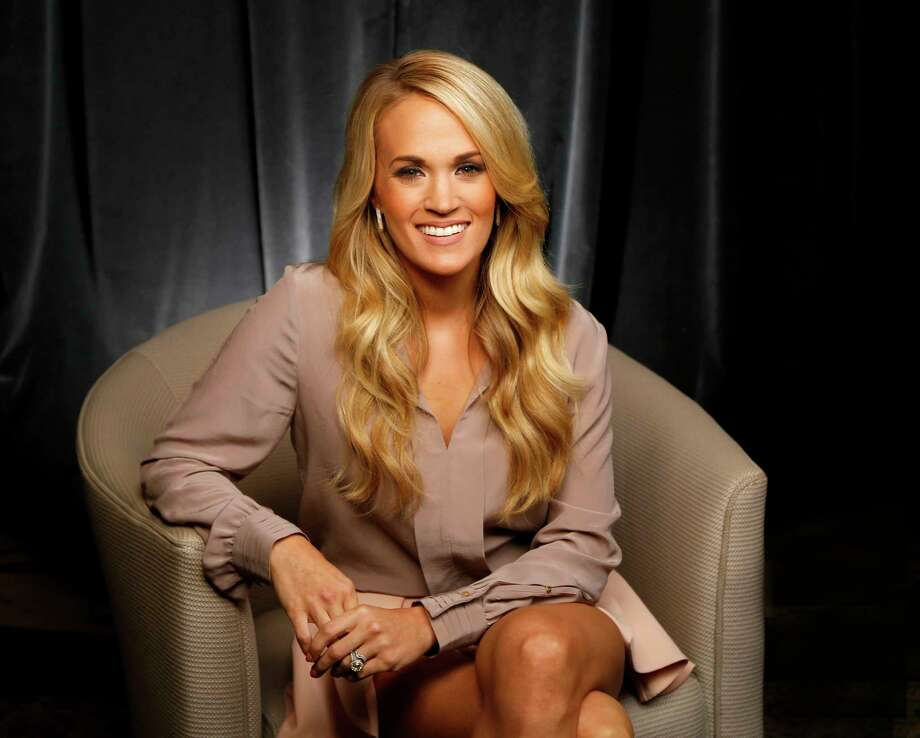 "In this Sept. 28, 2015, file photo, Carrie Underwood poses for a portrait at Sony Music Nashville in Nashville, Tenn., to promote her latest album, ""Storyteller."" ABC announced Wednesday, Oct. 28, 2015, that the country star will perform a number of her hits during ""Dick Clark's New Year's Rockin' Eve with Ryan Seacrest"" in New York City's Times Square. The special, which airs live, starts at 8 p.m. EDT. Photo: Photo By Donn Jones/Invision/AP, File    / Invision"