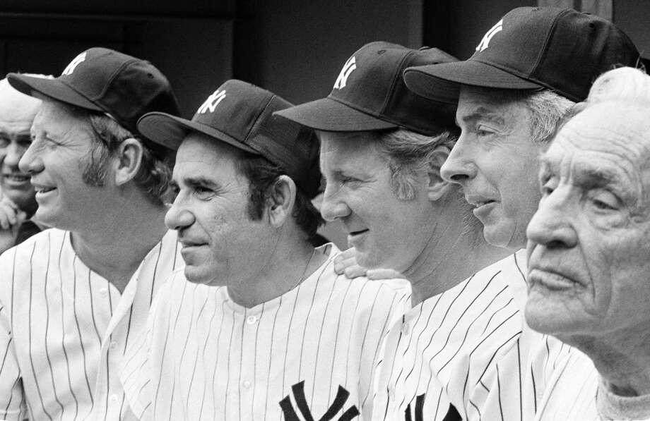 The Associated Press File Photo   Yankees greats, from left, Mickey Mantle, Yogi Berra, Whitey Ford, Joe DiMaggio and Casey Stengel gather on the steps of Shea Stadium in New York before an Old Timer's game in 1973. What made Berra standout in this group of baseball greats, is that his iconic status went well beyond the playing field. Photo: AP / AP