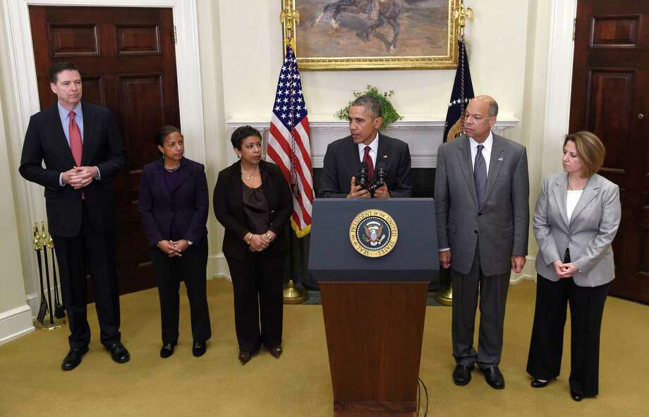 President Barack Obama updates the public on the nation's homeland security posture heading into the holiday season from the Roosevelt Room of the White House in Washington, Wednesday, Nov. 25, 2015. From left are, FBI Director James Comey, National Security Adviser Susan Rice Susan Walsh, Attorney General Loretta Lynch, Homeland Security Secretary Jeh Johnson and Assistant to the President for Homeland Security and Counterterrorism Lisa Monaco. Photo: AP Photo/Susan Walsh    / AP