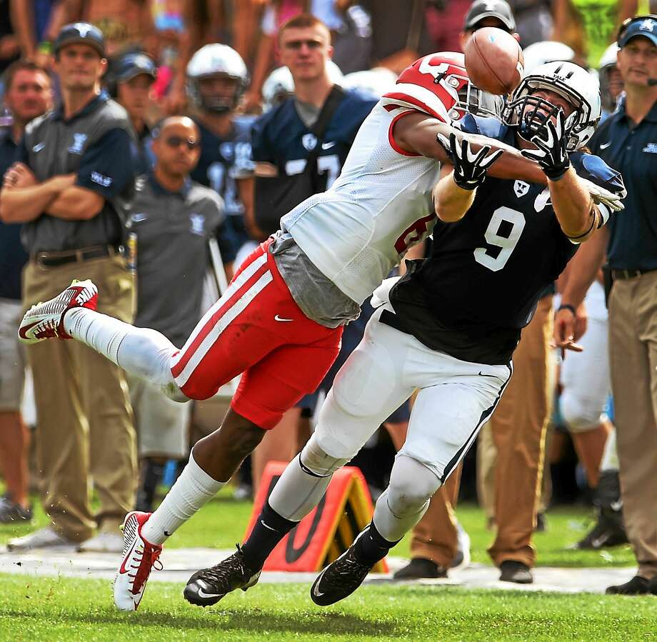 (Peter Hvizdak -New Haven Register)  Yale wide receiver Michael Siragusa makes a long pass reception against Cornell cornerback Jarrod Watson-Lewis during second quarter football action at Yale Bowl in New Haven, Connecticut Saturday, September 26, 2015. Photo: ©2015 Peter Hvizdak / ©2015 Peter Hvizdak