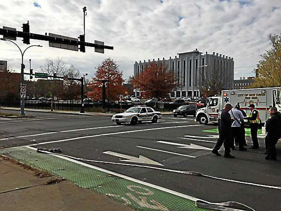 The scene of an accident Wednesday morning near South Frontage Road and Church Street in New Haven. A witness says the accident involved a car and a New Haven ambulance. Photo: Esteban Hernandez — New Haven Register