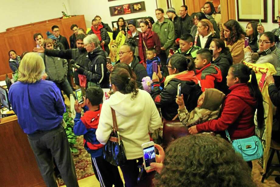 Demonstrators pack Mayor Toni Harp's office Wednesday, demanding a meeting with the mayor to address alleged nonpayment of wages at a local restaurant. Photo: Esteban L. Hernandez — New Haven Register