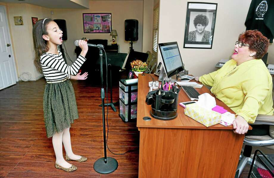Nora Mullins, left, 11, of West Haven practices with her voice coach, Cathryn Kenzel in Branford Wednesday. Photo: Arnold Gold — New Haven Register