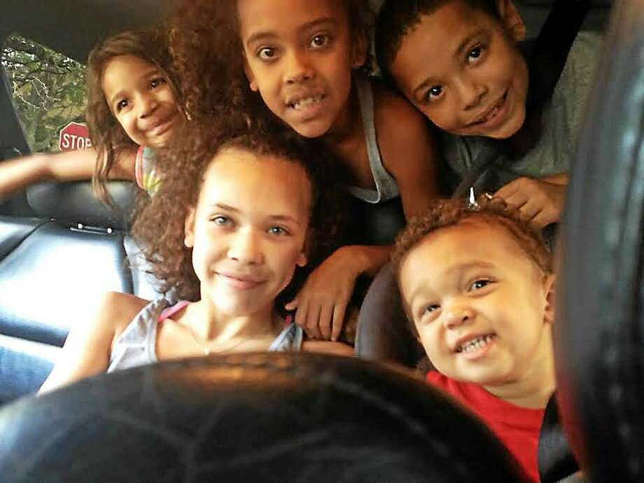 Yomaly Rivera's family from left, Thatiana, 4; twins Jada and Joel, 9. In front: Yoelys, 12 and Yadier, 2. Photo: (Mary O'Leary — New Haven Register)