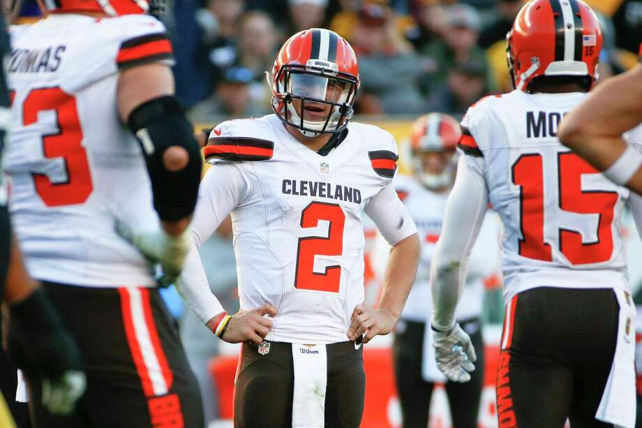 Cleveland Browns coach Mike Pettine says he's disappointed with quarterback Johnny Manziel's off-field behavior and may bench him. Photo: Gene J. Puskar — The Associated Press   / AP